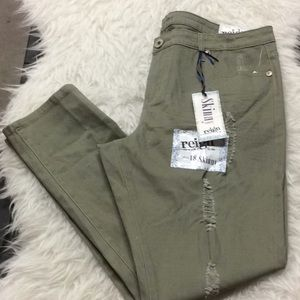 Reign destroyed army green skinny jeans